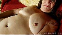 Beautiful mature brunette fucks her juicy pussy...