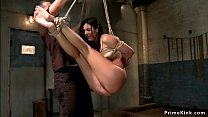 Brunette is flogged in suspension
