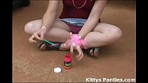 Innocent teen Kitty blowing bubbles