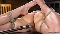 Laid in bondage brunette takes machine