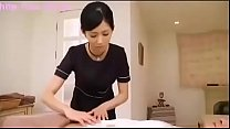 Japanese brunette performs massage and handjob