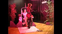 Luscious domina has fun with a blonde hussy and performs a striptease