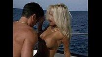 Busty lifeguard having fun on a boat.