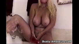 Busty Heather masturbates her pussy in the tub