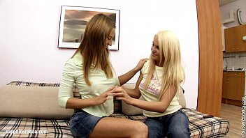 Natural tits Alla and Jodi play with a dildo on Sapphic Erotica