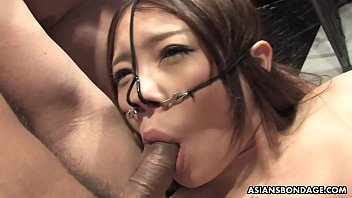 Slutty Asian babe fucked by the boys in a spitroast session