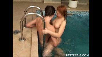 Couple having sex in a pool