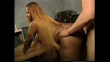 Ebony chick in a pink latex dress Hot Chocolate takes a hard black cock in her wet pussy on the desk