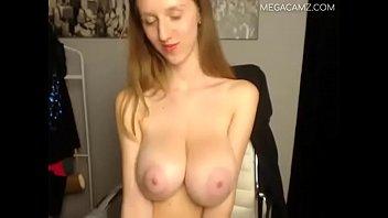 Big boobed woman uses a red dildo to masturbate her pussy 09773 megacamz.com