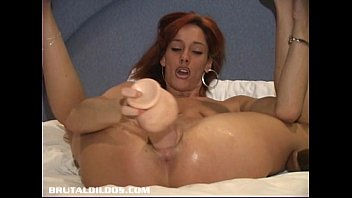 Babe with two big brutal dildos