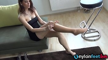 Hot brunette in tan pantyhose gives you a perfect feet show