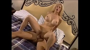 Blonde with huge tits loves a big dick filling up her wet little slit on the bed