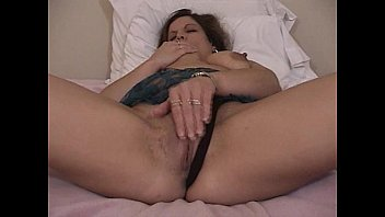 Dildo fucking brunette playing with herself