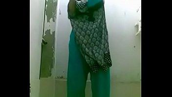 bottle bating indian wife in shower for a selfie