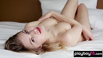 Busty blonde german babe Katja Tez teasing on the bed
