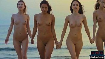 Four enjoy beach...