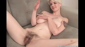 Amateur blonde with big natural boobs rubs her hairy pussy