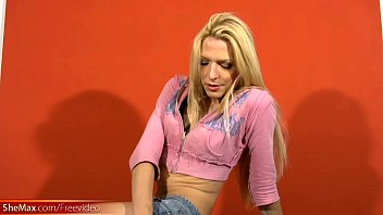 Feminine t-girl pulls out long shemale shaft and big balls