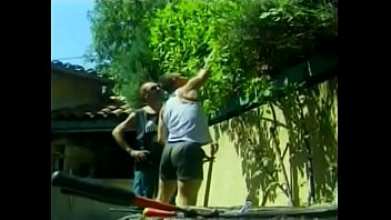 Open-handed gardener is not against to share his hard tool with his assistant