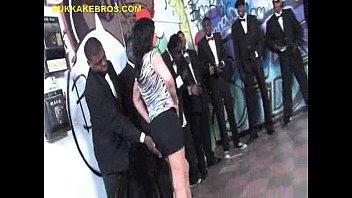 Brunette deepthroating a group men...