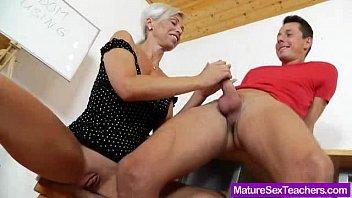 Mature pussy teacher licks a student's cock