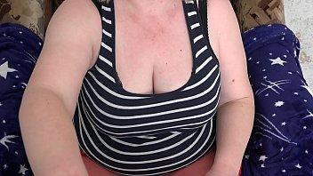 Milf masturbates dildo in front of webcam and shakes big natural tits.