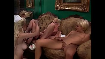 Sexy blonde nurses rub their pussies and suck on a dildo together