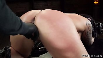 Busty slave is shackled and toyed