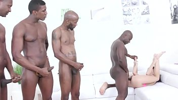 Several blacks stand in line to put their cock in a redhead