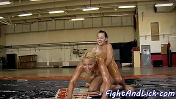 Lezzies wrestling and fingering in oil