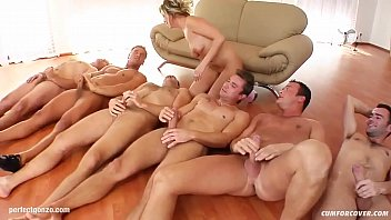 Syndy Love gets a messy bukkake after blowgang group blowjob