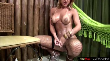 Bigtitted tranny covers her dick in whipping cream and jerks