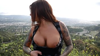 Felicity Feline  plays with her ass with a but  ass with a buttplug outdoors in