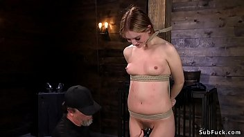 Zippered and hogtied brunette tormented