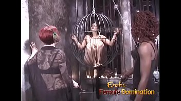 Streaming Video Two kinky mistresses take it out on a caged brunette slave - XLXX.video