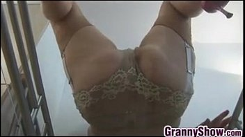 Granny shows off her breasts...