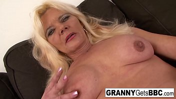 Granny with fake tits gets her pussy pounded by black cock
