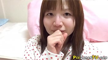 Asian babe pees into cups
