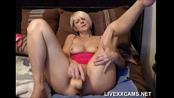 Hot older blonde Milf plays with her pussy in bed