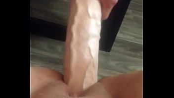 Giving it to her with two huge dildos