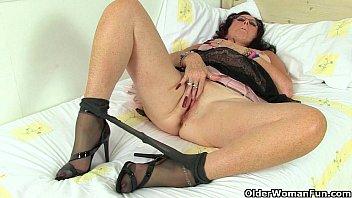 British milf Raven works her nyloned pussy