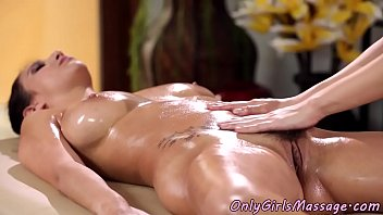Lesbian masseuse scissoring with busty babe