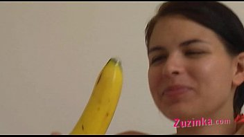 How-to: Young brunette girl teaches using a banana