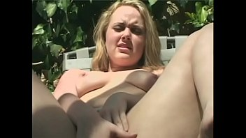 Fair-haired beauty Amber Peach fills her twat with fingers and massages her toes and feet