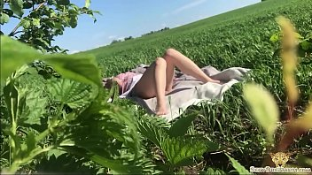 Girl Fingering in Middle of Field Excited by Thought that Neighbor is Watching