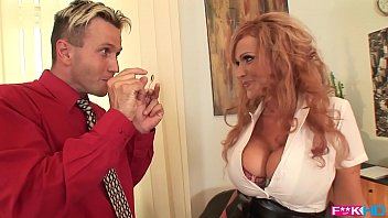 Busty redhead Sharon Pink is a dream secretary that loves titty fucking