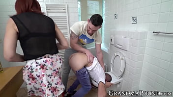 Ginger GILF pegging her young BF before sucking two dicks