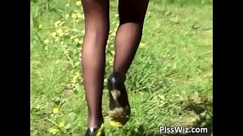 Outdoor fetish pissing action as slut