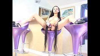 Nasty Asian mom with big boobs and raven hair down to the floor Ange Venus likes to play with her favorite toy sitting on the bar stool