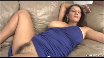 Busty milf rubbing her hairy pussy